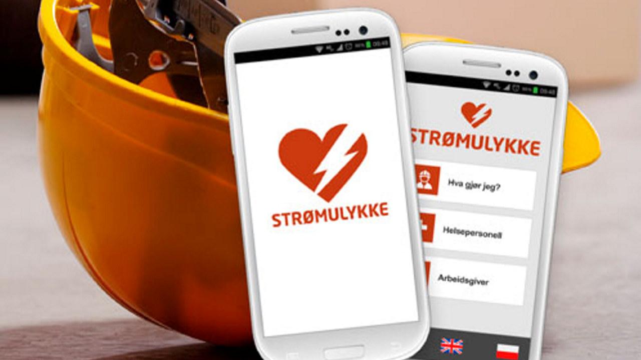 Mobiltelefoner med app om strømulykker, sammen med gul hjelm