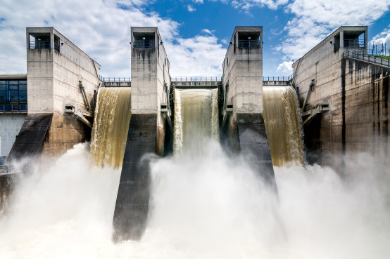 Draining water from the hydroelectric dam.