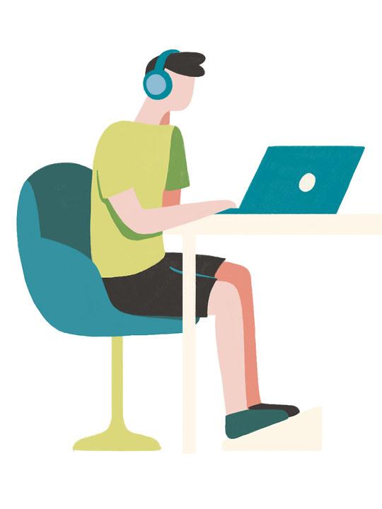 Illustrasjon: En ung mann skriver på en PC og har på seg høretelefoner.
